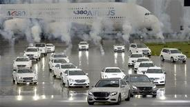 Two new Daimler S-Class cars (front) are displayed during a presentation at the Airbus plant in Hamburg, May 15, 2013. REUTERS/Fabian Bimmer
