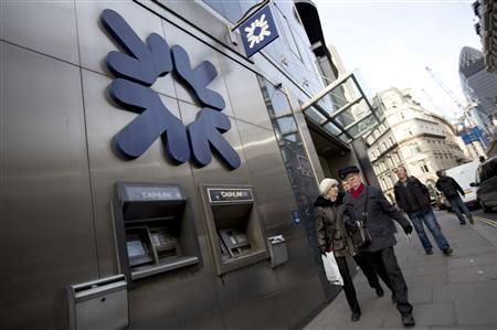 Pedestrians walk past a Royal Bank of Scotland building in central London February 28, 2013. REUTERS/Neil Hall