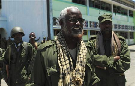 Somalia's Sheikh Ahmed Madobe, leader of the Ras Kamboni, a pro Mogadishu militia which has fought alongside the Kenyan Defence Forces in southern Somalia, is seen with his troops at the main seaport of Somalia's port city of Kismayu, October 5, 2012. REUTERS/Richard Lough