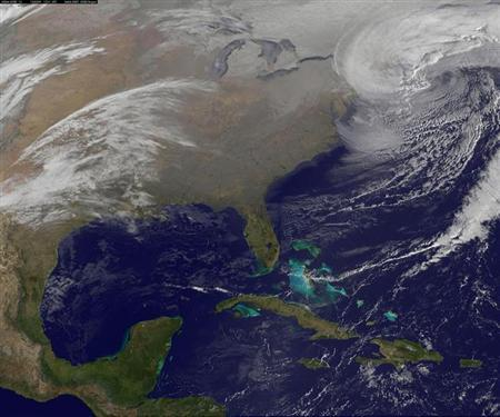 NOAA's GOES-13 satellite image taken on February 9, 2013 at 7:01 a.m. EST (1200 GMT) shows two low pressure systems that came together and formed a giant nor'easter centered right over New England creating blizzards from Massachusetts to New York. REUTERS/NASA/GOES Project/Handout