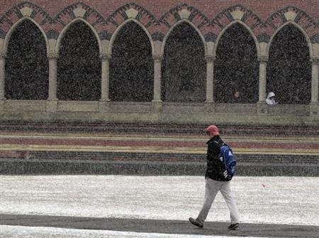 A pedestrian walks through a late winter snow storm outside Harvard University in Cambridge, Massachusetts February 29, 2012. REUTERS/Brian Snyder