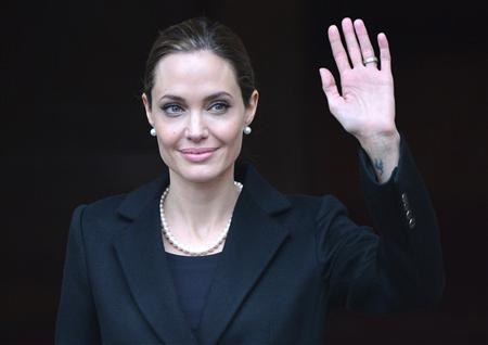 U.S. actress and humanitarian campaigner Angelina Jolie leaves a G8 Foreign Ministers Meeting in London in this April 11, 2013 file photo. REUTERS/Toby Melville/Files