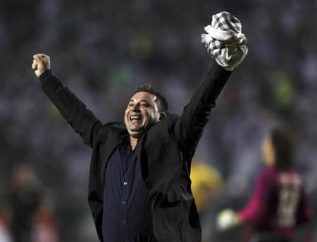 Antonio Mohamed headcoah of Mexico's Tijuana reacts after his team defeated Brazil's Palmeiras during their Copa Libertadores soccer match in Sao Paulo May14, 2013. REUTERS/Paulo Whitaker