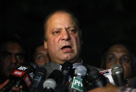 Nawaz Sharif, incoming prime minister and leader of political party Pakistan Muslim League-Nawaz (PML-N), talks to journalists after visiting Imran Khan, Pakistani cricketer-turned-politician and chairman of political party Pakistan Tehreek-e-Insaf (PTI), outside the Shaukat Khanum hospital in Lahore May 14, 2013. REUTERS/Mohsin Raza