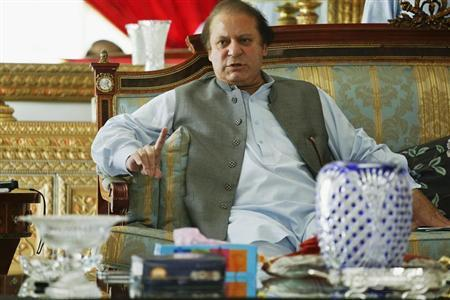 Nawaz Sharif, the leader of Pakistan Muslim League - Nawaz (PML-N), points as he speaks to foreign reporters at his residence in Lahore May 13, 2013. Sharif, who is poised for victory after Pakistan's May 11 election, said he had spoken at length with Prime Minister Manmohan Singh of rival India and would work to ease mistrust. REUTERS/Damir Sagolj