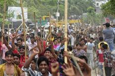 Garment workers shout slogans as they block a street during a protest to demand capital punishment for those responsible for the collapse of the Rana Plaza building in Savar, outside Dhaka April 30, 2013. REUTERS/Khurshed Rinku