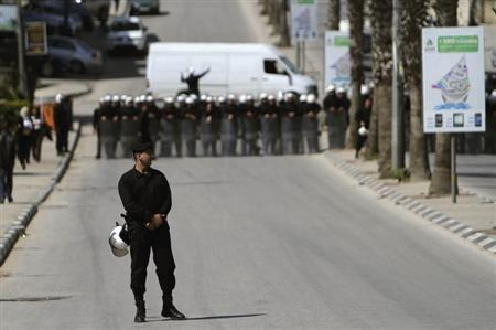 Palestinian police officers block the road to prevent Palestinian demonstrators from marching towards the Jewish settlement of Beit El March 30, 2011 during a rally marking Land Day in the West Bank city of Ramallah. REUTERS/Mohamad Torokman
