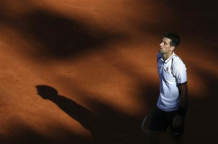 Novak Djokovic of Serbia pauses during his men's singles match against Albert Montanes of Spain at the Rome Masters tennis tournament May 14, 2013. REUTERS/Alessandro Bianchi
