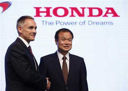 Honda Motor Co's President and Chief Executive Officer Takanobu Ito (R) shakes hands with McLaren Group Limited CEO Martin Whitmarsh at their joint news conference in Tokyo May 16, 2013. REUTERS/Issei Kato