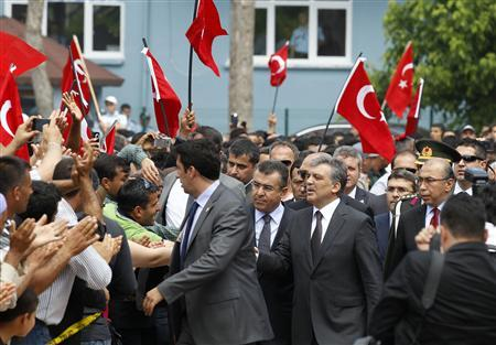 Turkey's President Abdullah Gul greets people as he visits one of the two blast sites, which resulted in the deaths of 51 people over the weekend, in the town of Reyhanli, in Hatay province near the Turkish-Syrian border, May 16, 2013. REUTERS/Umit Bektas