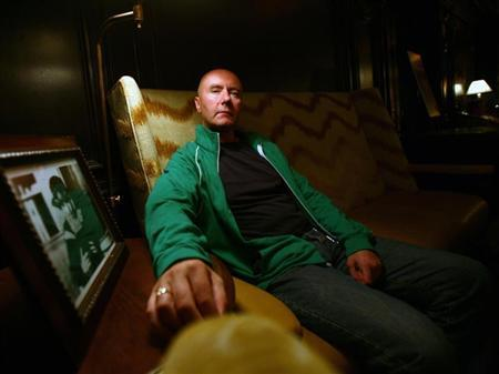 Scottish author Irvine Welsh, best known for the gritty Edinburgh novel ''Trainspotting,'' poses at the Algonquin Hotel in New York August 14, 2006. REUTERS/Shannon Stapleton