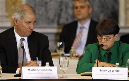 Mary Jo White, Chair of the Securities and Exchange Commission (R) and Martin Gruenberg, Chairman of the U.S. Federal Deposit Insurance Corporation (FDIC) (L) attend the Treasury Department's Financial Stability Oversight Council in Washington April 25, 2013. REUTERS/Gary Cameron