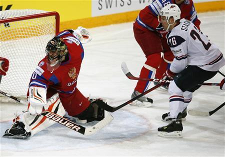 Team USA's Paul Stastny (R) scores past Russia's goalie Ilya Bryzgalov during their 2013 IIHF Ice Hockey World Championship quarter-final match at the Hartwall Arena in Helsinki May 16, 2013. REUTERS/Grigory Dukor