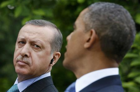 Turkish Prime Minister Recep Tayyip Erdogan (L) listens as U.S. President Barack Obama (R) addresses a joint news conference in the White House Rose Garden in Washington, May 16, 2013. REUTERS/Kevin Lamarque