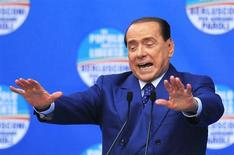 People of Freedom party member Silvio Berlusconi gestures as he makes an address on stage in Brescia May 11, 2013. REUTERS/Alessandro Garofalo