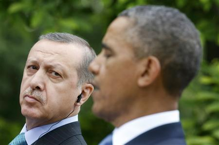Turkish Prime Minister Recep Tayyip Erdogan (L) listens to U.S. President Barack Obama during a joint news conference in the White House Rose Garden in Washington, May 16, 2013. REUTERS/Kevin Lamarque