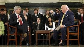 Canada's Prime Minister Stephen Harper (L) speaks with Conservative Senator Mike Duffy during the G8/G20 National Youth Caucus on Parliament Hill in Ottawa May 17, 2010. REUTERS/Chris Wattie