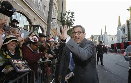 Cast member Steve Carell waves at fans at the premiere of ''The Incredible Burt Wonderstone'' in Hollywood, California March 11, 2013. REUTERS/Mario Anzuoni