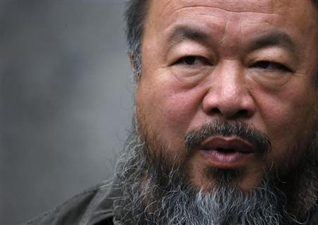 Dissident Chinese artist Ai Weiwei answers a question during an interview at his studio in Beijing September 27, 2012. REUTERS/David Gray