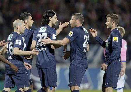Javier Pastore (3rd L) of Paris St-Germain celebrates with team mates after scoring against Evian Thonon Gaillard during their French Cup quarter-final soccer match in Annecy, April 17, 2013. REUTERS/Robert Pratta/Files