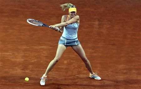 Maria Sharapova of Russia hits a return to Sloane Stephens of the U.S. during their women's singles match at the Rome Masters tennis tournament May 16, 2013. REUTERS/Alessandro Bianchi