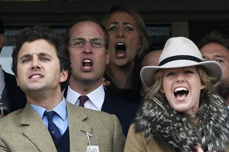 Britain's Prince William (2nd L) reacts as he watches The Gold Cup race at the Cheltenham Festival horse racing meet in Gloucestershire, western England, March 15, 2013. REUTERS/Stefan Wermuth