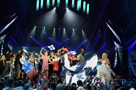 Finland's Krista Siegfrids (R) celebrates making it to the final after the second semi-final of the 2013 Eurovision Song Contest at the Malmo Opera Hall in Malmo May 16, 2013. REUTERS/Jessica Gow/Scanpix Sweden