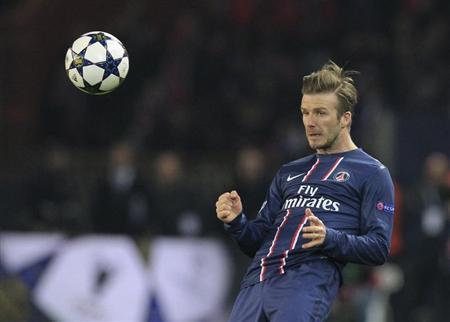 Paris St Germain's David Beckham reacts during their Champions League quarter-final first leg soccer match against Barcelona at the Parc des Princes Stadium in Paris, April 2, 2013. REUTERS/Gonzalo Fuentes