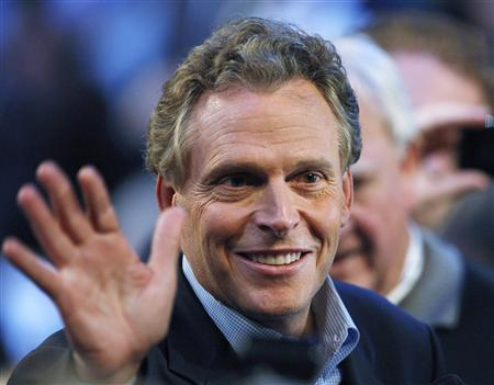 Terry McAuliffe, former chairman of the Democratic National Committee and also the former chairman of the Hillary Clinton for President committee, waves at the 2008 Democratic National Convention in Denver, Colorado in this August 26, 2008, file photo. REUTERS/Chris Wattie/Files