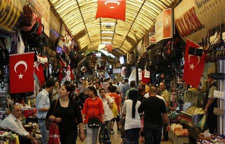 People shop in a shopping district in Hatay May 17, 2013. REUTERS/Umit Bektas