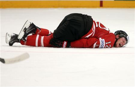 Canada's Eric Staal (R) lies injured on the ice during their 2013 IIHF Ice Hockey World Championship quarter-final match against Sweden at the Globe Arena in Stockholm May 16, 2013. REUTERS/Arnd Wiegmann