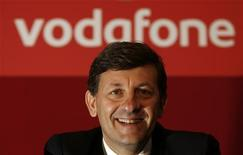 Vodafone's new Chief Executive Vittorio Colao poses for photos after their company's annual general meeting in a conference centre in Westminster, London July 29, 2008. REUTERS/Andrew Winning