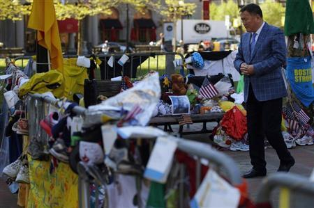 Amir Ismagulov, the father of Azamat Tazhayakov, visits the makeshift memorial for the victims of the Boston Marathon bombings in Boston, Massachusetts May 7, 2013. REUTERS/Brian Snyder