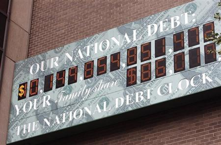 The National Debt Clock, a billboard-style sign, is seen near Times Square in New York October 9, 2008. REUTERS/Mike Segar