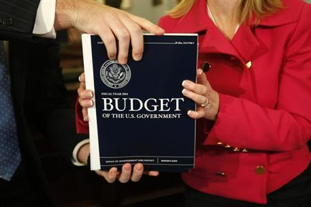 House Budget Committee member Marsha Blackburn (R-TN) is handed a copy of U.S. President Barack Obama's FY2014 budget proposal upon its arrival on Capitol Hill in Washington April 10, 2013. REUTERS/Kevin Lamarque