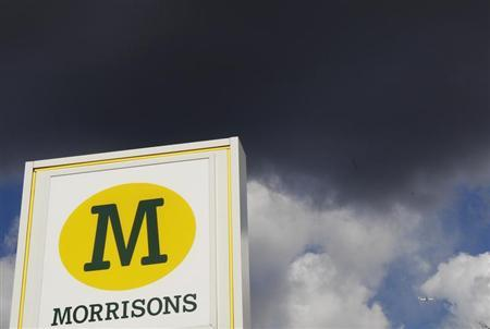 A Morrisons sign is seen outside a supermarket in north London March 14, 2013. REUTERS/Luke MacGregor