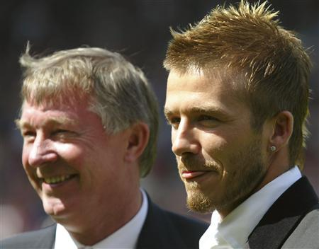 Manchester United's David Beckham (R) stands with manager Sir Alex Ferguson before their match against Charlton Athletic in the English premier league match at Old Trafford,Manchester, in this May 11, 2002 file photo. REUTERS/Ian Hodgson/Files