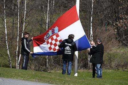The Croatian flag is hoisted at half mast at the training facility of soccer team AIK Solna in Stockholm in this May 2, 2013 picture provided by Scanpix Sweden. Swedish football club AIK's Croatian goalkeeper Ivan Turina has been found dead in his northern Stockholm apartment, according to local media reports on May 2, 2013. REUTERS/Claudio Bresciani/Scanpix Sweden/Files