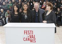 Director Arnaud Desplechin (2ndR) and cast members Gina McKee (R), Misty Upham (2ndL) and Michelle Thrush pose during a photocall for the film 'Jimmy P.' (Psychotherapy of a Plains Indian) at the 66th Cannes Film Festival in Cannes May 18, 2013. REUTERS/Eric Gaillard