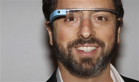 Google founder Sergey Brin poses for a portrait wearing Google Glass before the Diane von Furstenberg Spring/Summer 2013 collection show during New York Fashion Week in this September 9, 2012 file photo. REUTERS/Carlo Allegri/Files