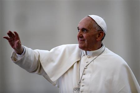 Pope Francis waves as he leads a Pentecost vigil mass in Saint Peter's Square at the Vatican May 18, 2013. REUTERS/Stefano Rellandini