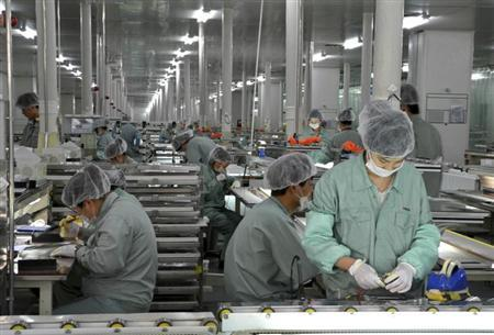 Employees work on a solar panel production line at Suntech Power Holdings headquarters in Wuxi, Jiangsu province, April 3, 2013. REUTERS/Stringer/Files