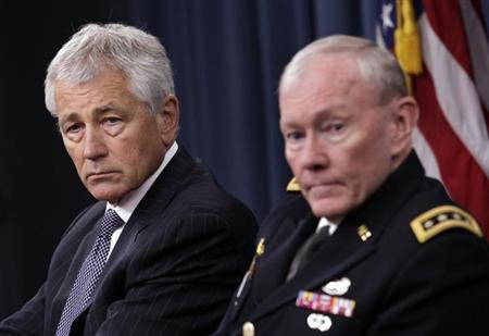 U.S. Secretary of Defense Chuck Hagel (L) and Joint Chiefs of Staff General Martin Dempsey hold a joint news conference at the Pentagon in Washington March 17, 2013. Hagel said on Friday the Pentagon will do everything necessary to ''fix'' the problem of sexual assault in the military after incidents in which those responsible for helping victims were accused of sex crimes. REUTERS/Yuri Gripas