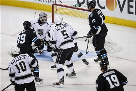 Members of the Los Angeles Kings and San Jose Sharks react as the game-winning puck shot by Sharks' Logan Couture (39) enters the goal in the overtime period during Game 3 of their NHL Western Conference semifinal playoff hockey game in San Jose, California May 18, 2013. REUTERS/Stephen Lam