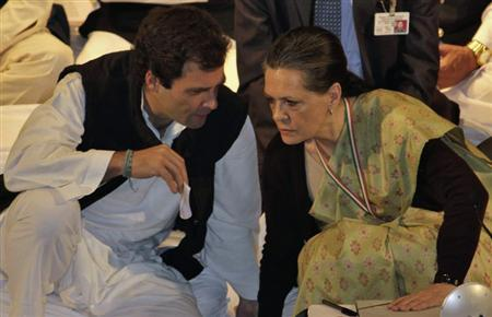 Rahul Gandhi, a lawmaker, speaks to Sonia Gandhi (R), who is his mother and India's ruling Congress party chief, during the Indian National Congress meeting in Jaipur, capital of India's desert state of Rajasthan January 20, 2013. REUTERS/Stringer
