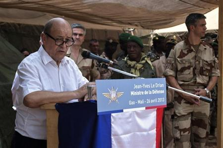 French Defence Minister Jean-Yves Le Drian speaks to French troops at the French military base at the airport in Gao, April 26, 2013. REUTERS/Francois Rihouay