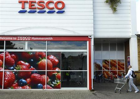 A man pushes his shopping trolley into a Tesco store in Hammersmith, west London October 3, 2012. REUTERS/Paul Hackett