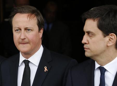Britain's Prime Minister David Cameron (L) and the leader of the opposition Labour Party Ed Miliband leave after a service to mark the 20th anniversary of the murder of teenager Stephen Lawrence, at St Martin-in-the-Fields church in London April 22, 2013. REUTERS/Luke MacGregor