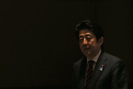Japan's Prime Minister Shinzo Abe attends a meeting hosted by Japan Akademeia in Tokyo May 17, 2013. REUTERS/Issei Kato