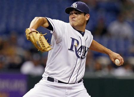 Tampa Bay Rays starting pitcher Matt Moore throws during the first inning of their MLB American League baseball game against the New York Yankees in St. Petersburg, Florida September 5, 2012. REUTERS/Mike Carlson